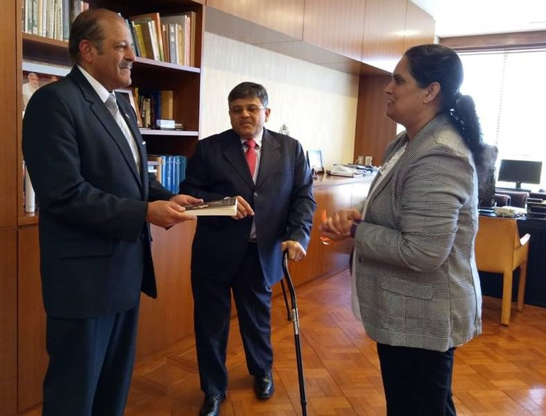 VoSAP founders gifts  book to H.E. Ambassador Shri Chinoy