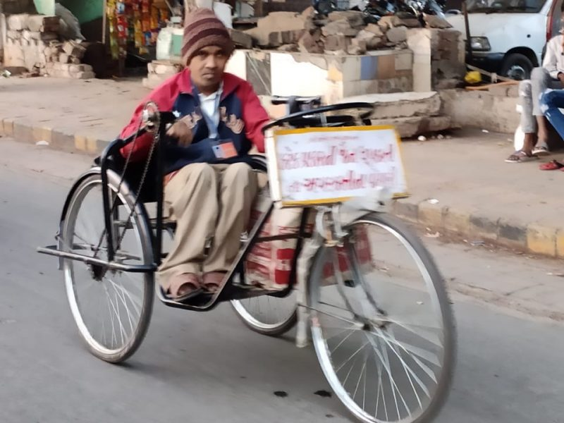 Sachin, Recipient of Tricycle from VOSAP, selling Incense Sticks, earning money! (Click for Photo)